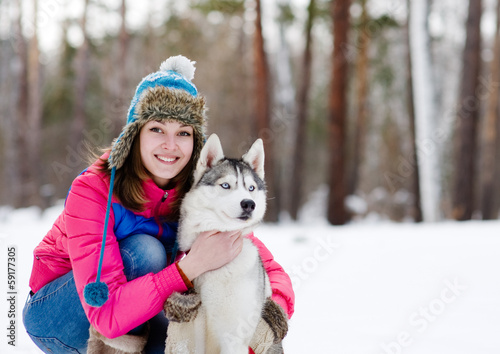 Portrait of a pretty young woman with her pet dog