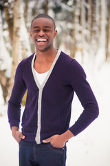 Smiling black man in the snow