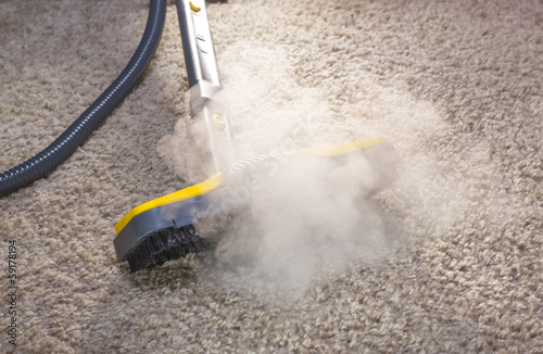 Leinwandbild Motiv Dry steam cleaner in action.