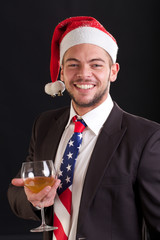 Businessman in Santa Hat and Stars and stripes Bow Tie