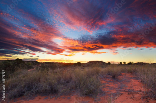 Beautiful kalahari sunset with dramatic clouds and grass