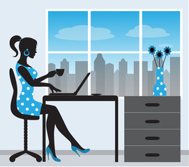 silhouette of a woman with a laptop