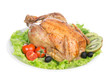 Garnished roasted christmas chicken on a plate decorated with sa