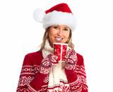 Christmas woman drinking hot tea.