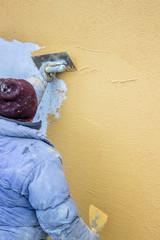 builder worker plastering facade 4