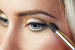 portrait of beautiful woman with brush for make-up