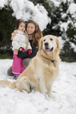 Family with a dog at snow