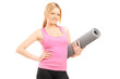 Young female with an exercising mat