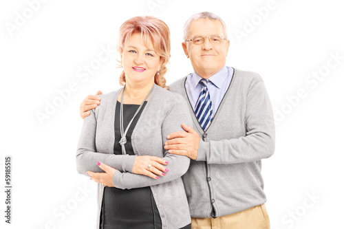 Middle aged couple posing