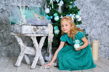 Beautiful blonde girl and Christmas tree