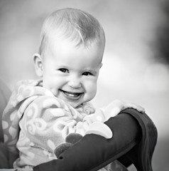 happy baby laughing and smiling monochrome