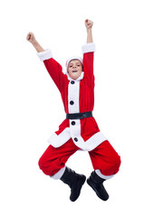 Boy in Santa Claus costume jumping - isolated
