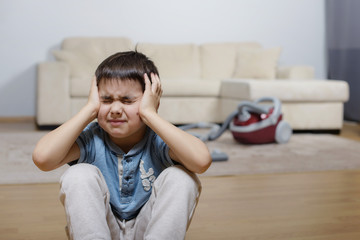 A child keeping his head and crying
