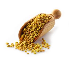 bee pollen in a wooden scoop