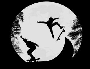 Skateboarders doing a flip trick