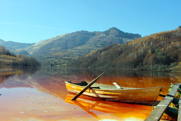 boat on polluted lake