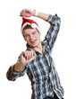 Teenager in a santa hat dancing