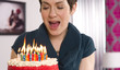 Attractive Female Readies to Blow Out Birthday Cake Candles