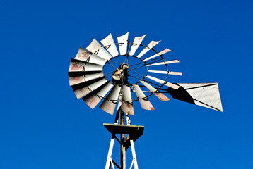 Westen metal windmill on sky