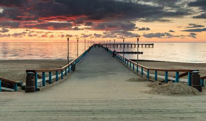 Sunset at a marine pier in resort city of Palanga