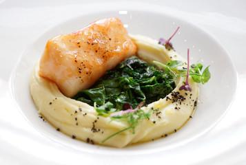 Fried black cod fillet close-up