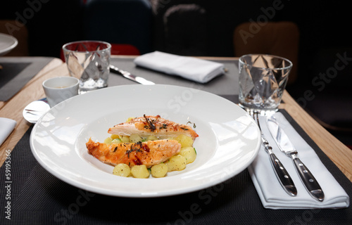 Chicken breast with potatoes on plate