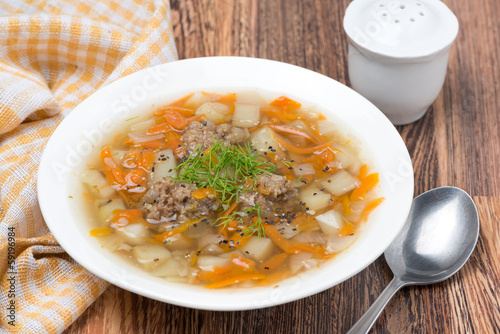 vegetable soup with meatballs in the plate