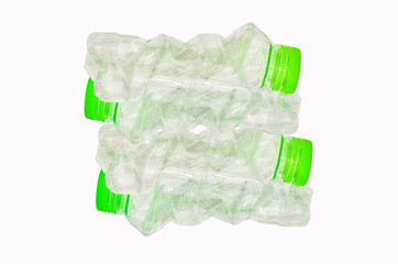recycling or stack of green plastic bottles
