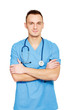 Young doctor man with stethoscope and crossed hands