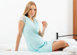 serious pregnancy woman  with thermometer