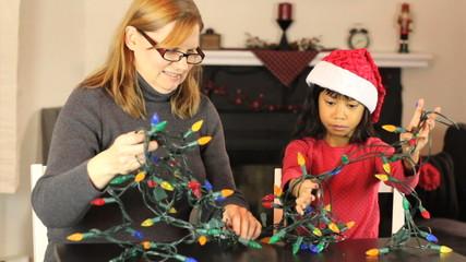 Girls Untangling Christmas Lights