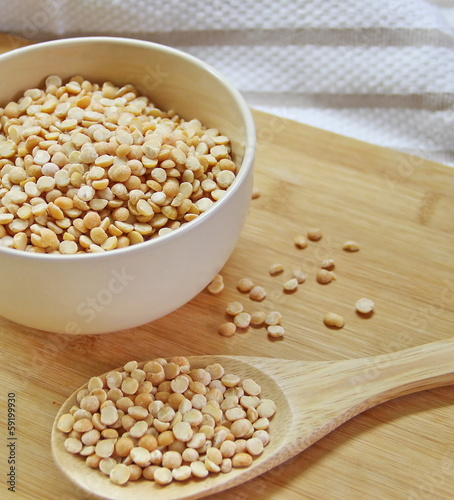 yellow pea on a wooden table
