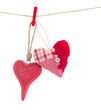 two bound hanging red  hearts on white