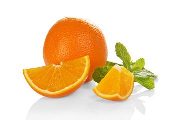 Big whole orange, slices of orange and the mint