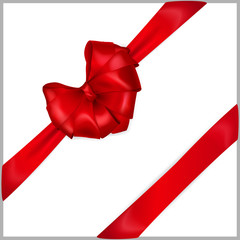 Red heart-shaped bow with diagonal ribbons