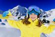 Ski, winter fun - lovely skier girl enjoying ski holiday
