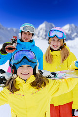 Ski and fun - young skiers enjoying winter holiday