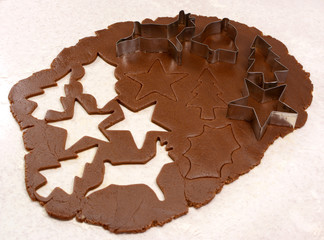 Gingerbread dough cutout shapes and biscuit cutters