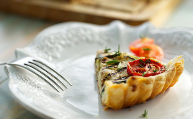 Tart with grilled zucchini and tomato