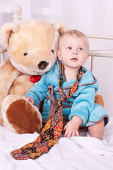 year-old child portrait in men's tie and toy bear