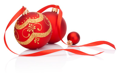 Red christmas decoration balls with ribbon bow isolated on white