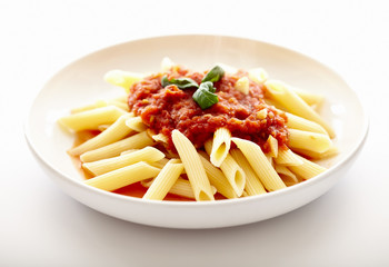 Traditional italian pasta with tomato sauce and basil