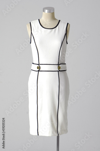 White dress mannequin isolated on gray background