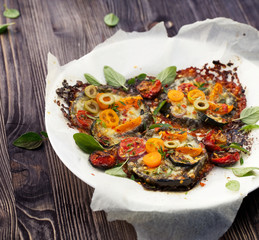 Grilled eggplants with mozzarella, parmesan and fresh herbs