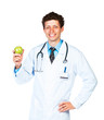 Portrait of a male smiling doctor holding green apple on white