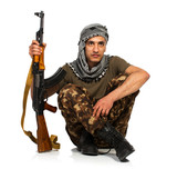 Arab nationality in camouflage suit and keffiyeh with automatic