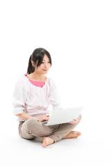 young asian woman using laptop on white background