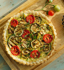 Quiche with grilled zucchini, tomato and herbs