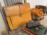 Vintage bag , books , and eyeglasses .