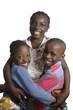 canvas print picture - Drei afrikanische Kinder halten sich im Arm